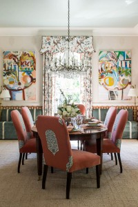 The dining room, designed by Margaret Kirkland Interiors, balances elegance and comfort with custom fabric treatments and playful colors.