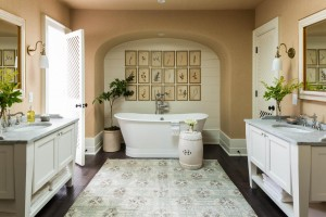 The master bathroom is designed to highlight the freestanding tub underneath the archway. Lauren Liess's natural interior design creates a serene setting.