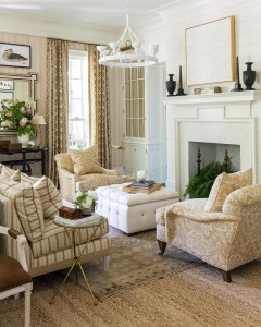 Designed by Mark Sikes, the living room has two seating sections, giving the room symmetry and highlighting the French doors leading to the porch.