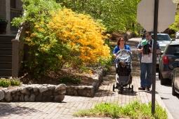Parents enjoy a stroll on quaint cobblestone sidewalk during the Mt Laurel Spring Festival.