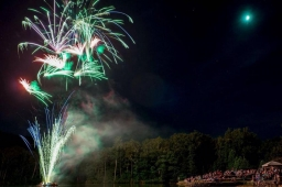 Fireworks paint the sky with color as residents gather to celebrate the 4th of July at Spoonwood Lake.