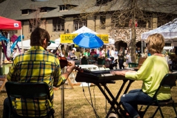 Live music creates a vibrant atmosphere as locals peruse artisan booths at the Mt Laurel Fall Festival.