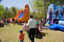 Children relish the opportunity to play in bounce houses and on slides at the Mt Laurel Spring Festival.