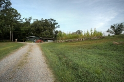 A gravel road leads to the barn on the Mt Laurel Farm.
