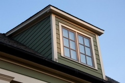 Dormer windows add extra appeal to this custom Craftsman-style home.