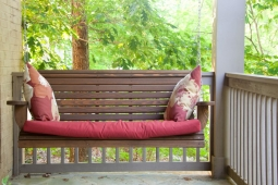 This comfy porch swing invites residents to enjoy a morning cup of coffee or an afternoon read.