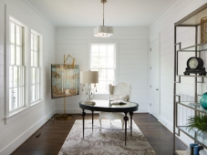 Flexible office featuring shiplap walls and hardwood floors.  Photo: Tommy Daspit