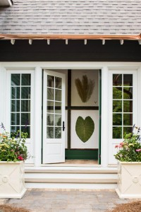 Beautiful French doors open to the courtyard and the hallway's large pressed botanicals bring the outdoors inside.