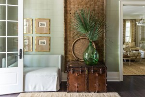 Designed by Ashley Gilbreath, the welcoming foyer features shiplap walls and a mix of contemporary and antique pieces.