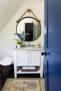A beautiful marble vanity highlights one of the upstairs bathrooms, just off of the bedroom designed by Ashley Gilbreath.
