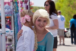 "A child meets ""Elsa"" at Mt Laurel's annual Spring Festival."