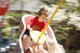 Children take a whirl on an amusement ride during the Mt Laurel Spring Festival.