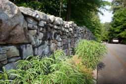 As a master-planned community, Mt Laurel considers every detail, including stonework walls .