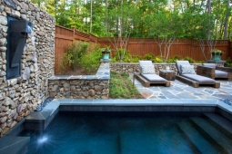 A pump recycles water into a backyard dipping pool.